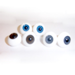 SOLID GLASS ROUND PAPERWEIGHT EYES